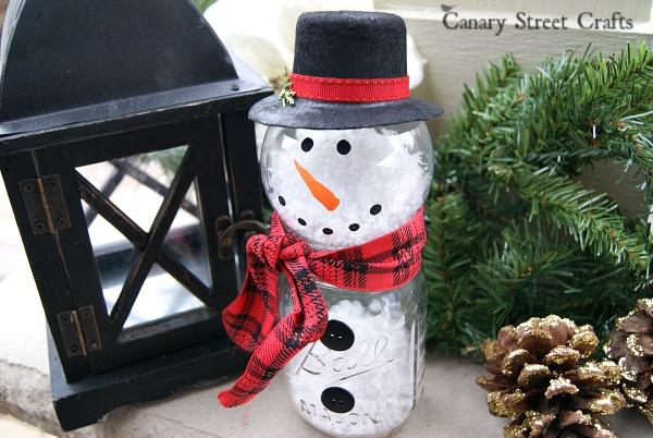 DIY mason jar and clear bauble snowman with faux snow (via canarystreetcrafts.com)