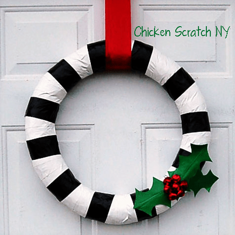 DIY duct tape wreath with holly berries and leaves