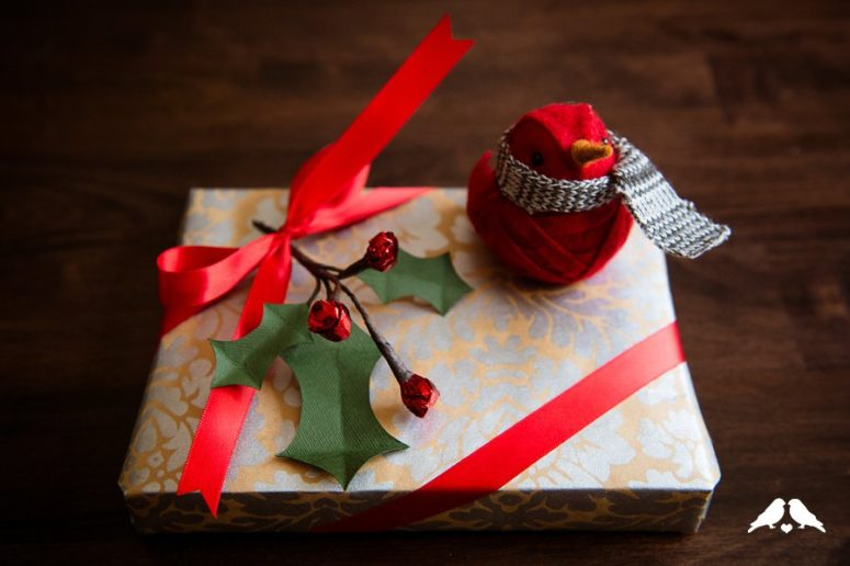DIY holly gift topper of paper and foil (via www.capitolromance.com)