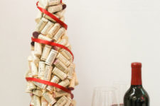 DIY wine cork Christmas tree covered with red ribbon