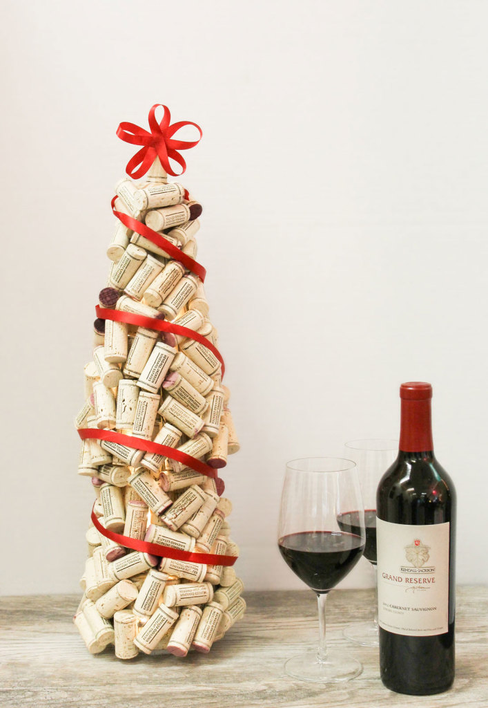 diy wine cork christmas tree covered with red ribbon via wwwkjcom