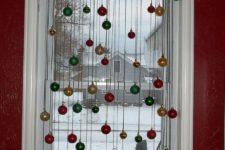 DIY Christmas window decor with small ornaments