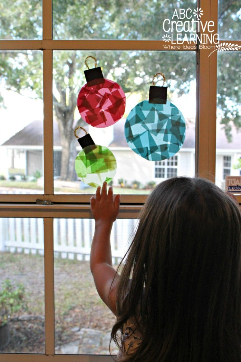 DIY glass stained window ornaments for kids to make (via abccreativelearning.com)