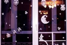DIY paper Christmas window decorations with a free template