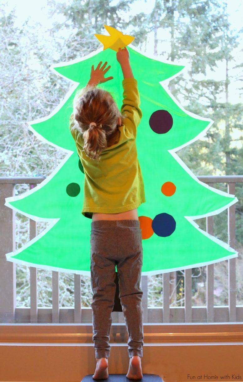 DIY sticky Christmas tree decorating activity (via www.funathomewithkids.com)