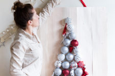 DIY Christmas ornament tree on a wooden plank