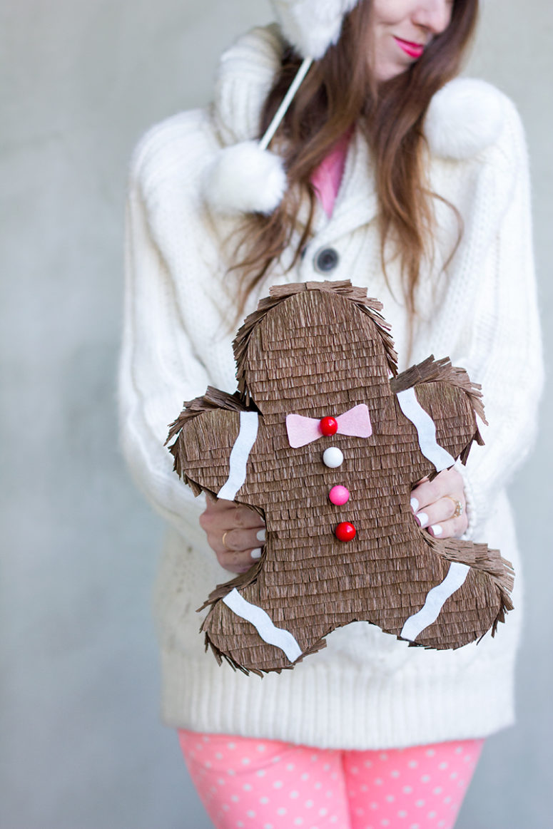 DIY gingerbread man pinata (via studiodiy.com)
