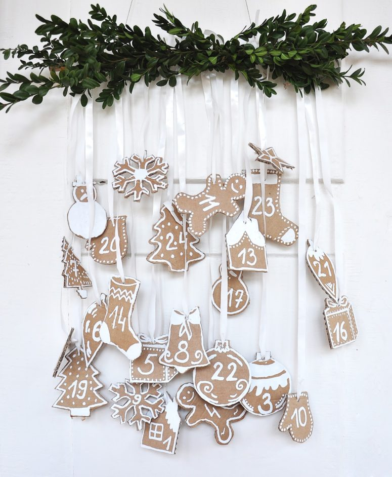 DIY advent calendar of cardboard and white paint (via spalvotasdryzuotas.blogspot.ru)