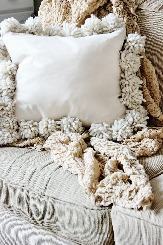 DIY drop cloth pompom pillow (via thistlewoodfarms.com)