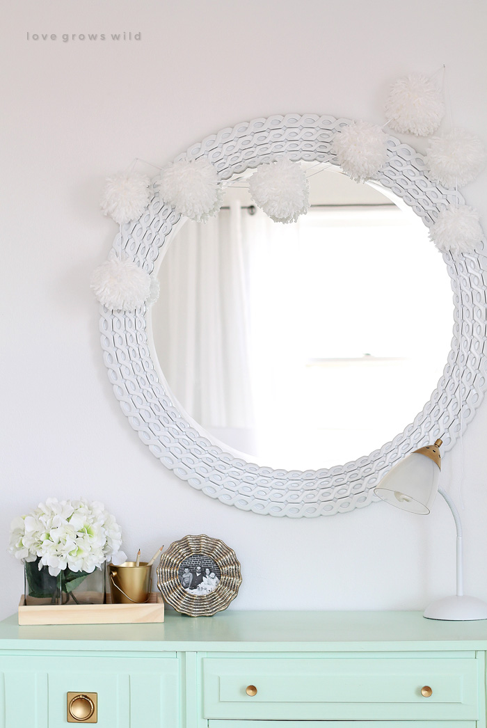 DIY pompom garland that reminds of snow (via lovegrowswild.com)
