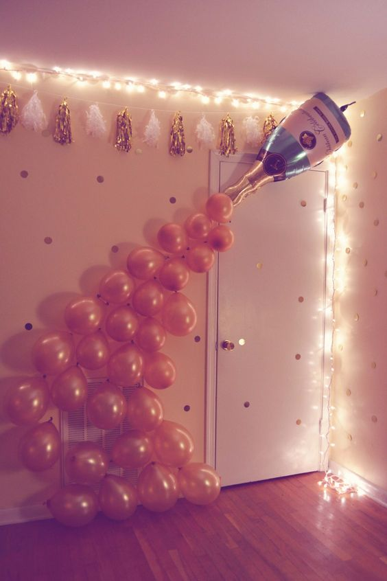 a balloon champagne bottle and balloons will make whimsy decor