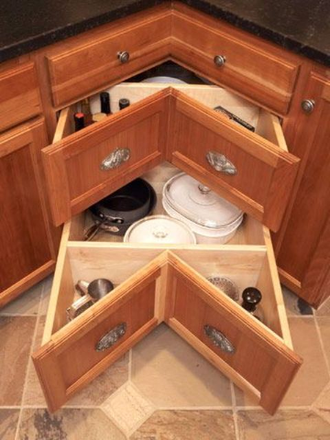 an angled drawer may be better than a spinner, corners are so deep and this would go all the way