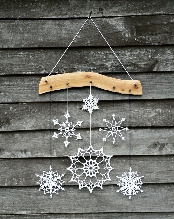 crochet snowflake and wood ornament for a cozy home