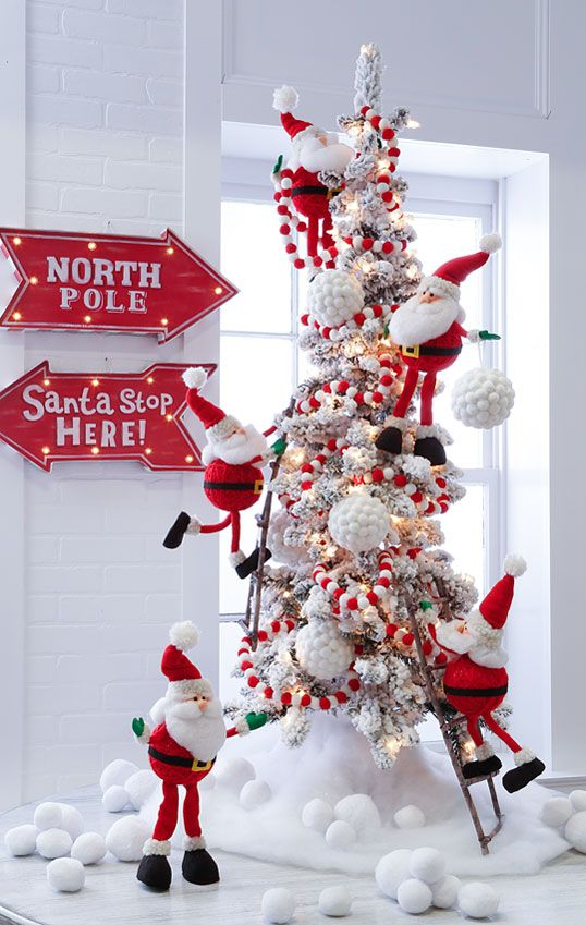 numerous Santa figures to decorate a tree and excite your kids