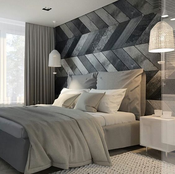 reclaimed wood clad headboard wall with a chevron pattern