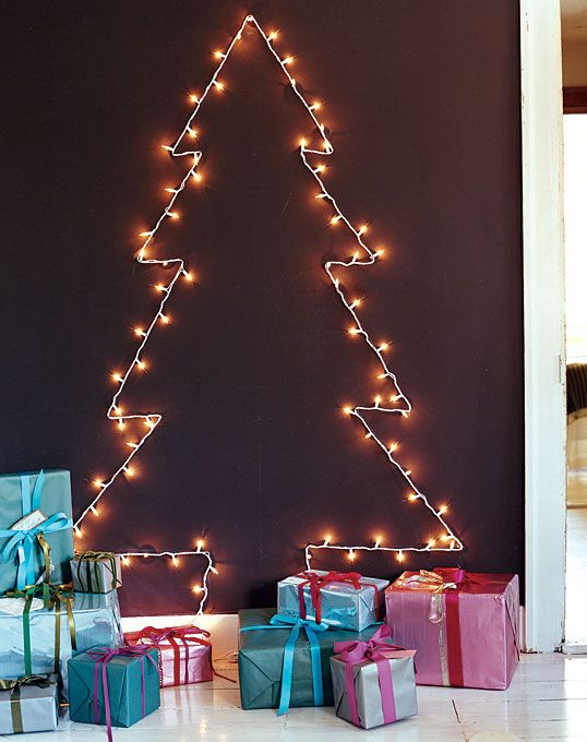 a lighted tree on a chalkboard wall for a contrast