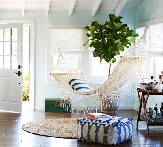 airy white hammock with fringe looks so cute