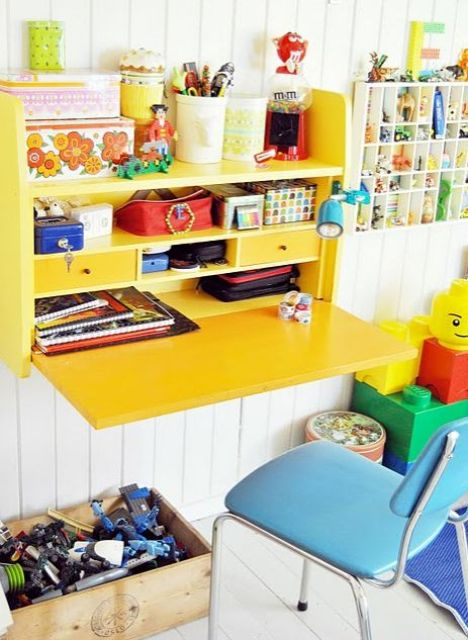colorful yellow fold out desk with storage space