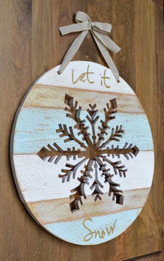 Let It Snow wooden sign with a cut out snowflake