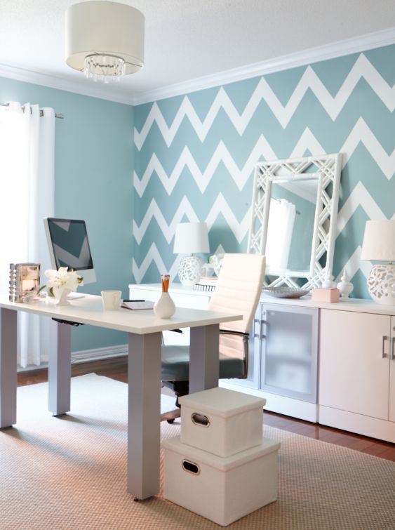 mint blue and white chevron accent wall in a home office