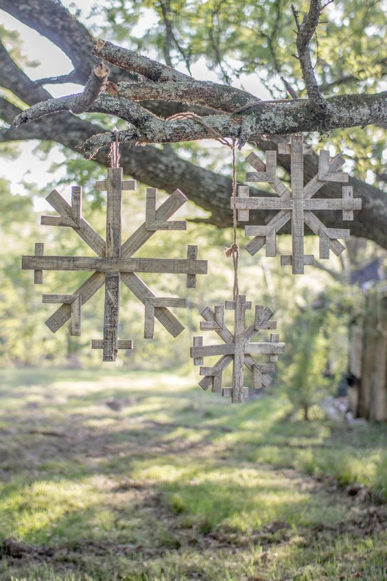 recycled wooden snowflakes for outdoor decor