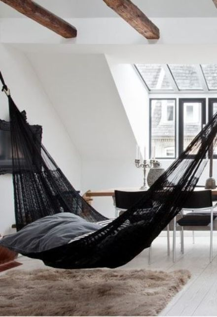 black crocheted hammock 26 ways to incorporate hammocks into your interior   shelterness  rh   shelterness
