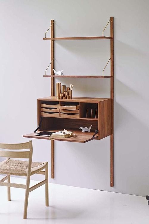 minimalist wooden bureau with a folding desk top