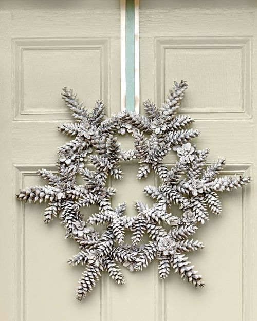snowy pincone wreath is a cool natural decoration