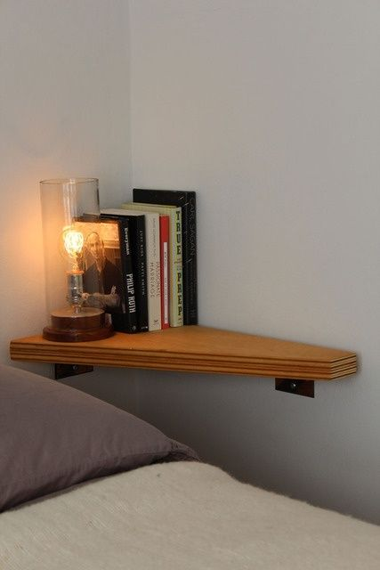 corner wall nightstand with a lamp