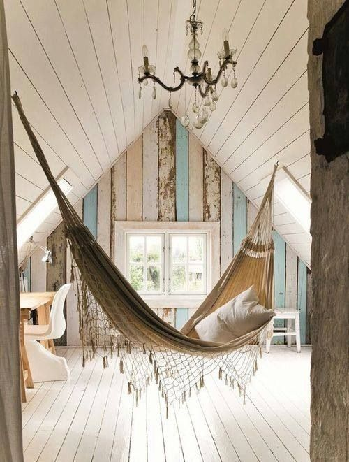 fabric and fringe boho-feel hammock in the attic