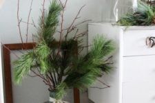 07 oversized round vase with evergreens and a ribbon bow