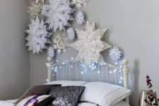 08 3D paper snowflakes over the bed for refined decor