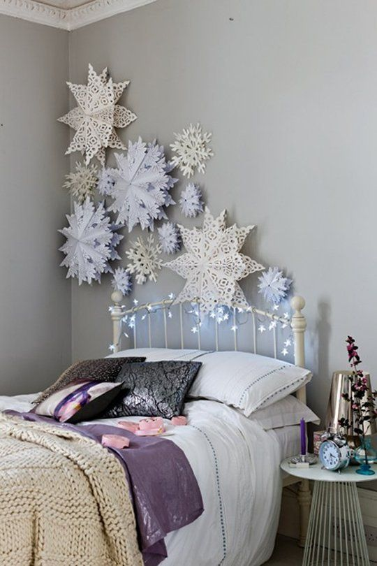 3D paper snowflakes over the bed for refined decor