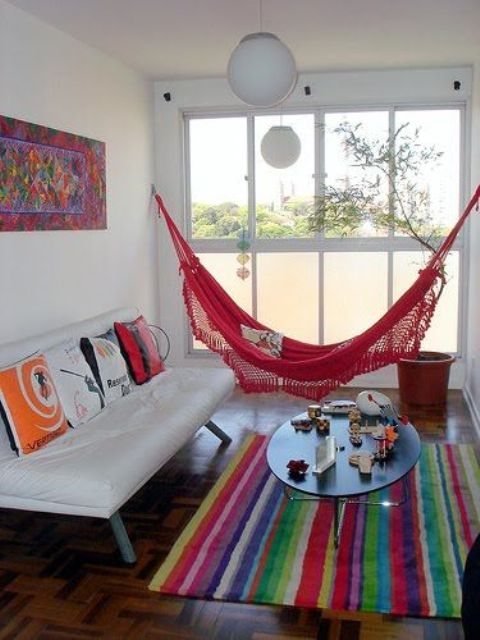 colorful living room and a bold red hammock
