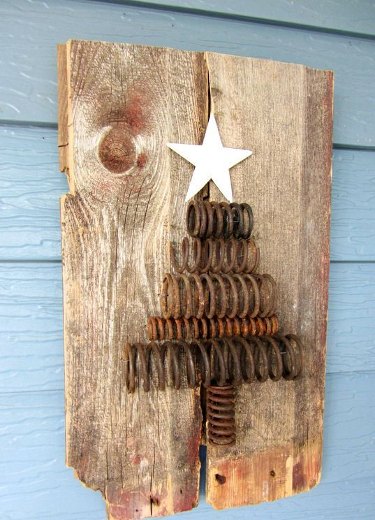 rusty spring Christmas tree on pallets