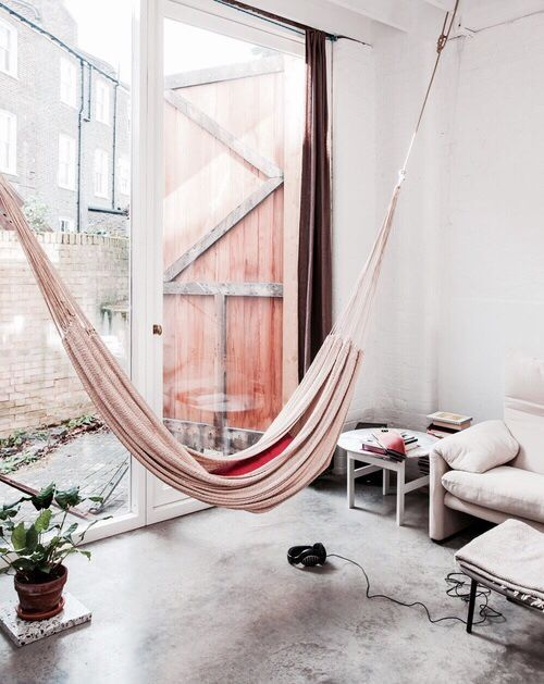 cozy room with a blush hammock is ideal for a girl