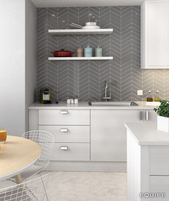 grey ceramic tiles with a chevron pattern in the kitchen