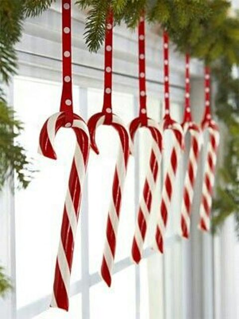 hang candy canes in kitchen window for an easy and joyous Christmas decorating idea