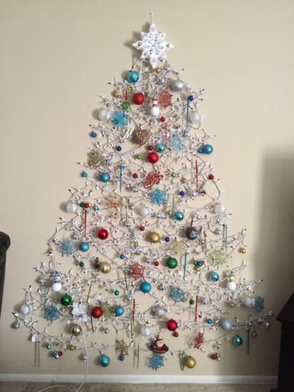 26 wall christmas trees to save the space shelterness light garland and ornaments hanging on it aloadofball