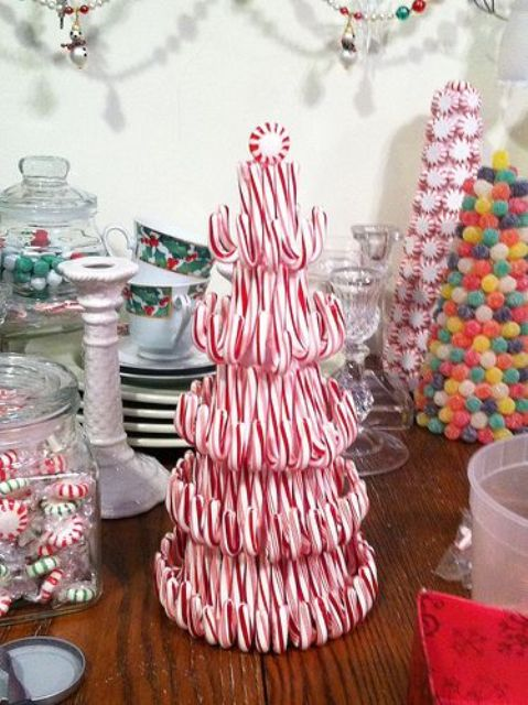 candy cane Christmas tree topped with a candy