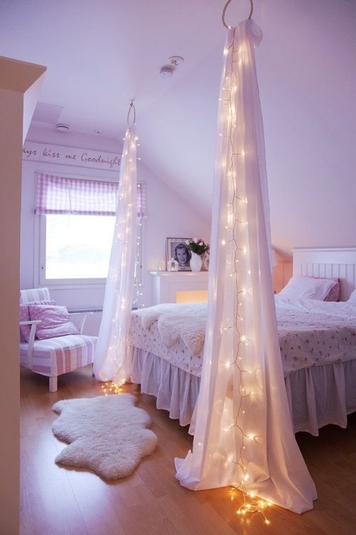 string lights in the curtains hanging from the ceiling