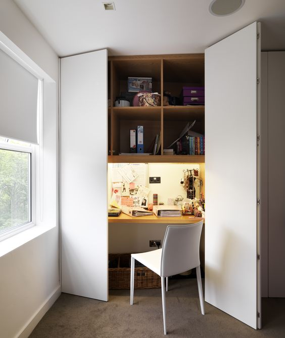 a built-in desk wardrobe conveniently utilises wasted space in the wardrobe