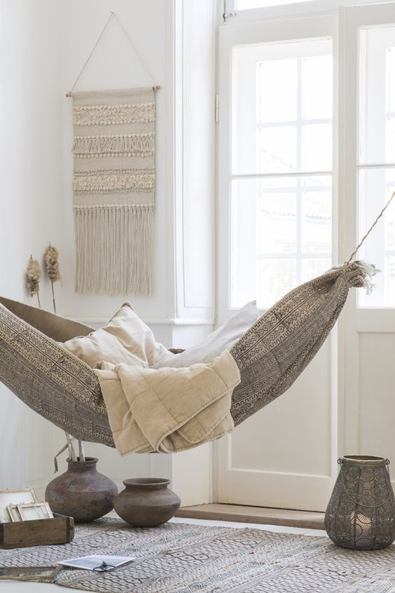 folk-styled hammock bed with blankets invites everyone