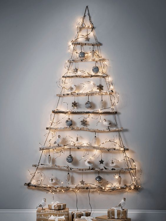 frosted branches Christmas tree with ornaments and LEDs