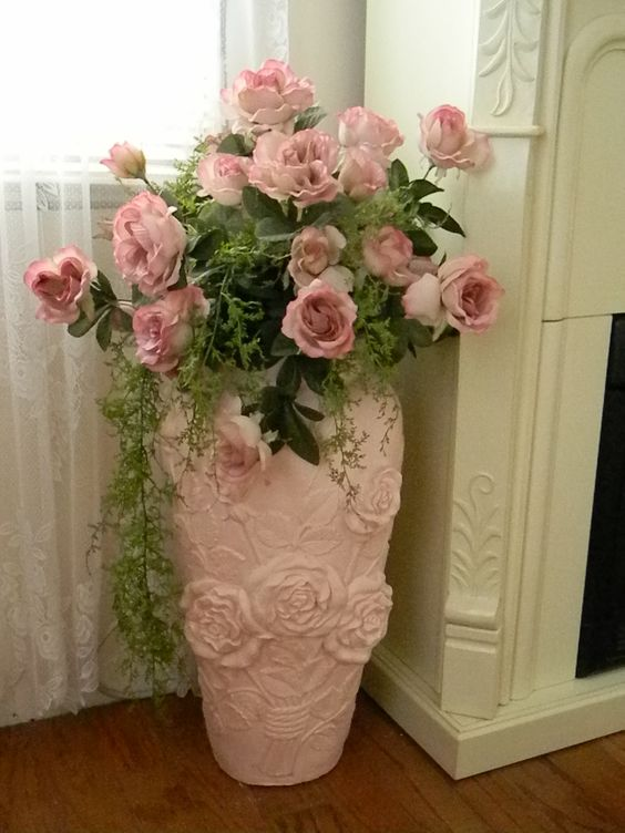pink porcelain vase with pink roses for a feminine room