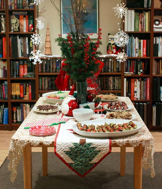 snack table with a fir tree table runner and evergreens