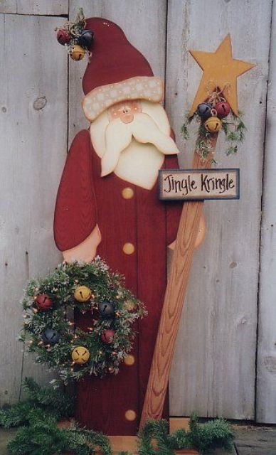 decorative Santa with an evergreen wreath and jingle bells