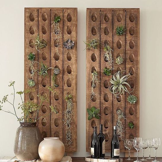 wooden boards with holes for displaying air plants