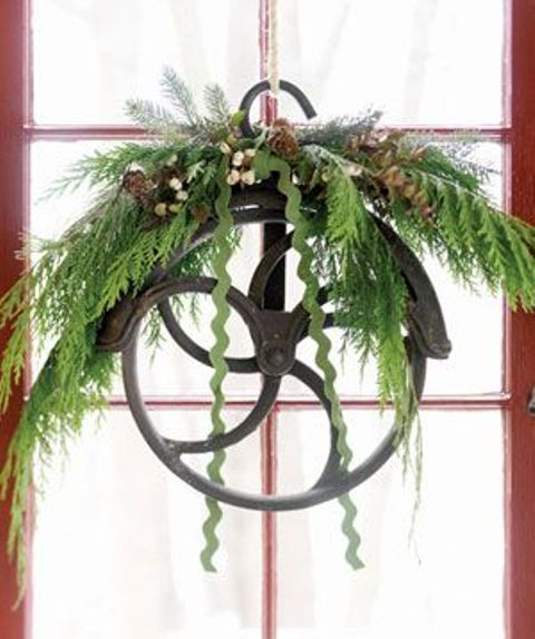 21 whimsical industrial christmas d cor ideas shelterness for Decorating with pulleys