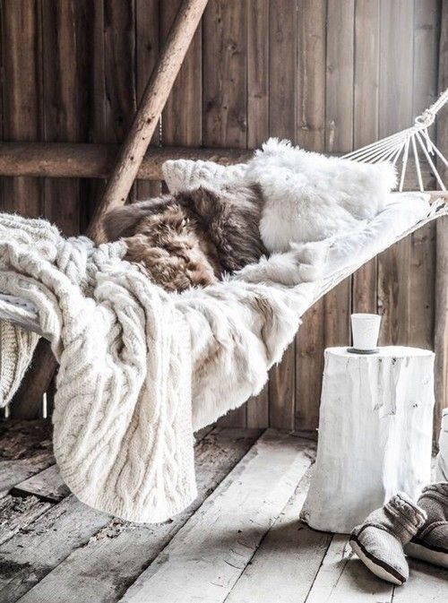 stylish hammock decorated for winter with faux fur and knit throws